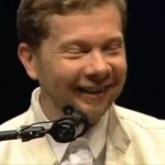 A photo of Eckhart Tolle smiling and talking about our essential nature